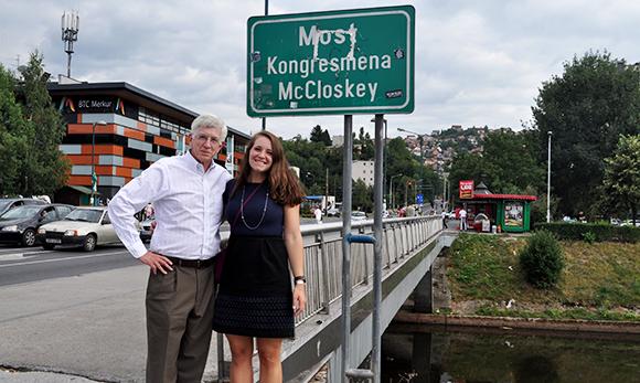 Emma Strenski with Grandfather Ed DeLaney near bridge
