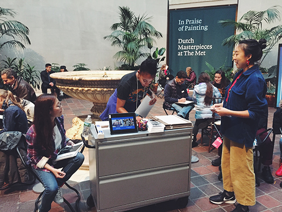 Shiloah Coley working with patrons at the Met